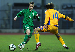 Rene Mihelic (10)  of Slovenia vs Raul Rusescu of Romania  during Friendly match between U-21 National teams of Slovenia and Romania, on February 11, 2009, in Nova Gorica, Slovenia. (Photo by Vid Ponikvar / Sportida)