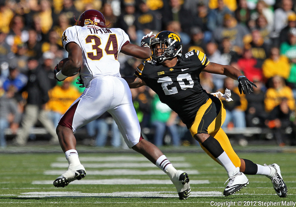 September 22 2012: Central Michigan Chippewas running back Zurlon Tipton (34) stiff arms Iowa Hawkeyes linebacker Christian Kirksey (20) during the first half of the NCAA football game between the Central Michigan Chippewas and the Iowa Hawkeyes at Kinnick Stadium in Iowa City, Iowa on Saturday September 22, 2012. Central Michigan defeated Iowa 32-31.