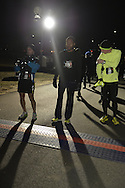 East Meadow, New York, USA. December 31, 2014. At center is runner TERRY LOUIS of Deer Park, who, at the stroke of midnight, will run - and then become the First Place winner, in a 5K New Year's Eve DASH to support the Long Island Council on Alcoholism and Drug Dependence (LICADD) at the Twin RInks Ice Center at Eisenhower Park in Long Island. A Skatin' New Year's Eve event started hours earlier and a New Year's Eve Party, open to runners, family and friends continued until 2:30 a.m.