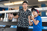 HOUSTON, TX - OCTOBER 3:  Dominick Cruz poses for a photo with a fan during the UFC 192 fan village at the Toyota Center on October 3, 2015 in Houston, Texas. (Photo by Cooper Neill/Zuffa LLC/Zuffa LLC via Getty Images) *** Local Caption *** Dominick Cruz