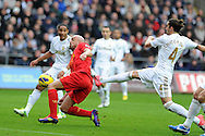 Liverpool's Jose Enrique  is challenged by Swansea's Chico Flores. Barclays Premier league, Swansea city v Liverpool at the Liberty Stadium in Swansea , South Wales on Sunday 25th November 2012. pic by Andrew Orchard, Andrew Orchard sports photography,