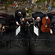 December 16, 2012 - New York, NY : Jack Quartet's, from left, Chris Otto (violin), Ari Streisfeld (violin), Kevin McFarland (cello), and John Pickford Richards (viola) take a bow after perform ?Modern Medieval?  in the Metropolitan Museum of Art's.Medieval Sculpture Hall on Sunday evening. CREDIT: Karsten Moran for The New York Times