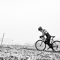 A Cyclocross rider tries to ride up a hill during a snowstorm at the Illinois Cyclocross Championships in Chicago
