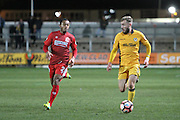Dan Butler of Newport County and Kallum Mantack of Alfreton Town during the The FA Cup match between Newport County and Alfreton Town at Rodney Parade, Newport, Wales on 15 November 2016. Photo by Andrew Lewis.