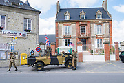 May 30, 2019, Sainte-Marie-du-Mont,  Normandy, France.<br /> Tourists dressed in military fatigues participates at  reenactments of military deeds from 1944. The 75th anniversary of D-Day and Battle of Normandy commemoration is a tourist attraction.   <br /> 30 Mai 2019, Sainte-Marie-du-Mont, Normandie, France. Des touristes vêtus de treillis militaires participent à la reconstitution d'actes militaires de 1944.