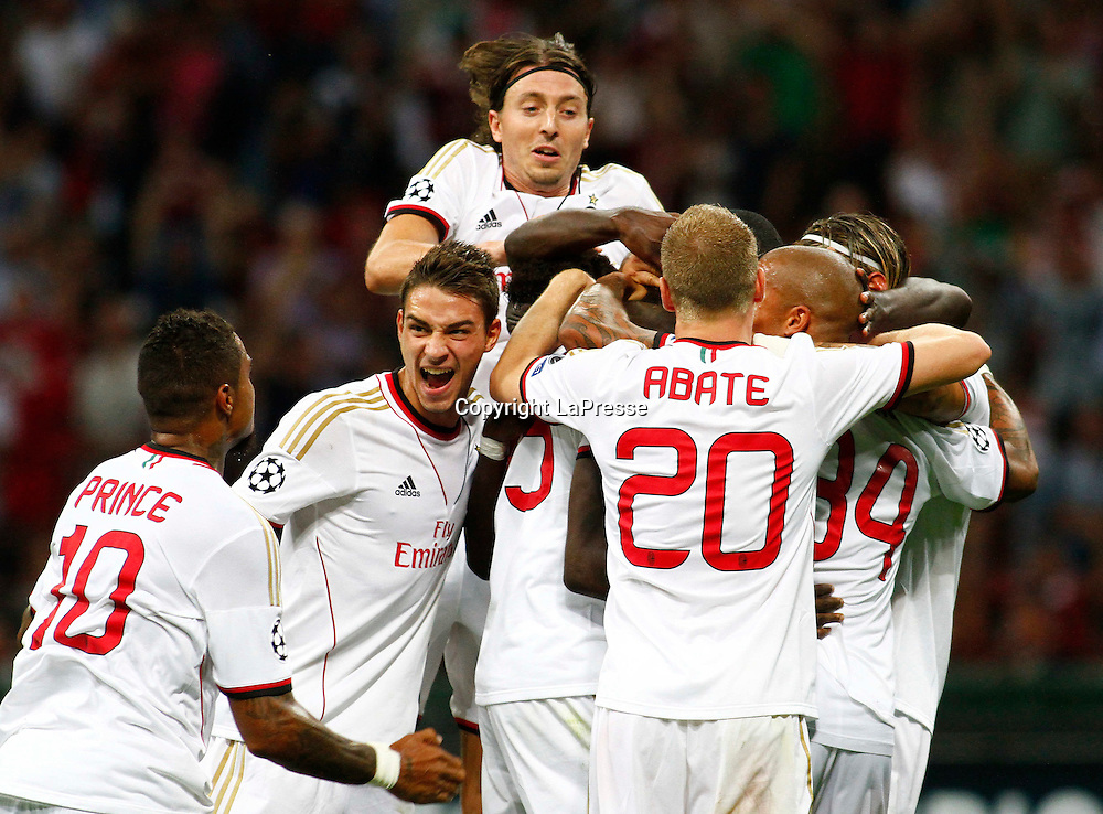 Foto Spada - LaPresse<br /> 28 08 2013 Milano, Italia<br /> UEFA Champions League 2013/2014 - Milan vs. PSV Eindhoven  <br /> Nella foto:  Balotelli esultanza gol 2-0 , Boateng montolivo de sciglio <br /> <br /> Photo Spada - LaPresse<br /> 28 08 2013 Milan, Italy<br /> UEFA Champions League 2013/2014 - Milan vs. PSV Eindhoven <br /> In the pic: Balotelli celebrates after scoring goal 2-0, Boateng  montolivo de sciglio