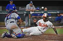 August 31, 2017 - Baltimore, MD, USA - The Baltimore Orioles' Tim Beckham, right, scores as the ball gets away from Toronto Blue Jays catcher Miguel Montero, left, in the eighth inningat Oriole Park at Camden Yards in Baltimore on Thursday, Aug. 31, 2017. The Blue Jays won, 11-8. (Credit Image: © Kenneth K. Lam/TNS via ZUMA Wire)