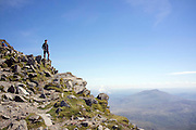 © Licensed to London News Pictures. 17/05/2014. Capel Curig, UK. A man looks at a view across Snowdonia. Walkers climb Snowdon in warm sunshine in North Wales today 17th May 2014. Photo credit : Stephen Simpson/LNP