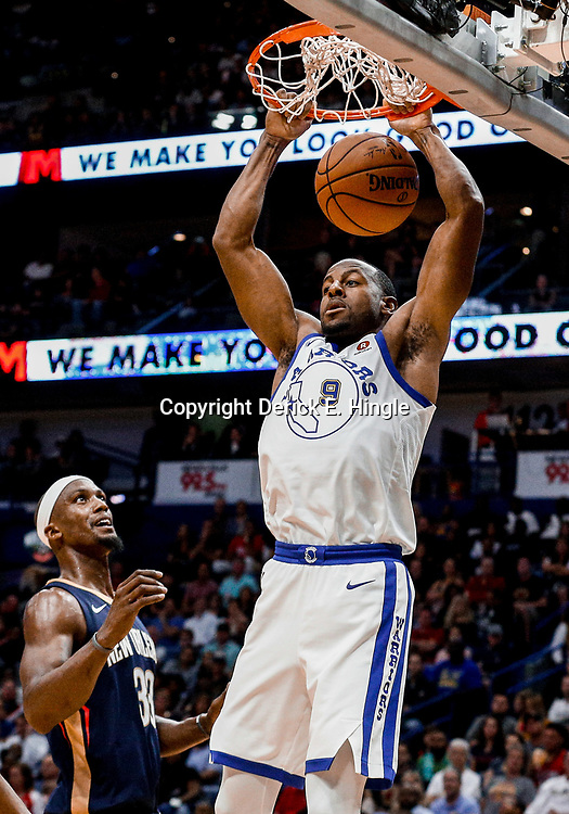 Oct 20, 2017; New Orleans, LA, USA; Golden State Warriors forward Andre Iguodala (9) dunks over New Orleans Pelicans forward Dante Cunningham (33) during the first quarter of a game at the Smoothie King Center. Mandatory Credit: Derick E. Hingle-USA TODAY Sports