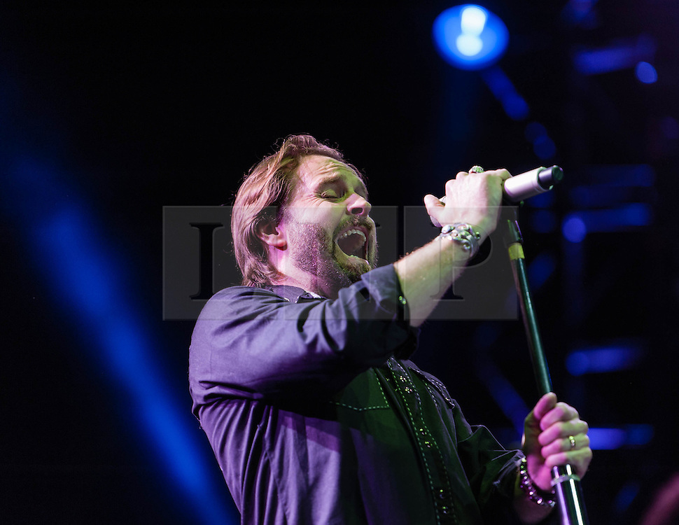 """© Licensed to London News Pictures. 16/09/2012. London, UK.  Alfie Boe performs at The Sunflower Jam at the Royal Albert Hall.  The Sunflower Jam is a British charity, founded by Jacky Paice, wife of Deep Purple drummer, Ian Paice. Other high-profile supporters are the actor Jeremy Irons, ex-Jamiroquai bassist Nick Fyffe and Charles, Prince of Wales. The aims of the charity are to fund complementary therapists and spiritual healers to work on cancer wards in the British National Health Service. After setting up a meeting between members of Deep Purple and a young boy dying of leukemia, Paice saw """"all the good work the healers were doing"""" and decided """"lets find a way to raise money to get more healers in there. Alfie Boe has just taken on the lead role of Jean Valijean in the 25th anniversary concert of Les Miserables.  Photo credit : Richard Isaac/LNP"""