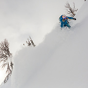 Jess McMillan about to tomahawk over an entire slope on her way to landing on the photographer Jay Goodrich in the Teton backcountry near Jackson Hole Mountain Resort, Teton Village, Wyoming.