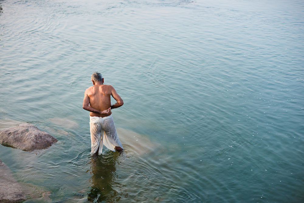 Early morning bathing in the Betwa River at the village of Orchha, India
