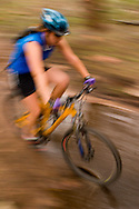 Mountain bikers riding through muddy trails in Lefthand Canyon near Boulder, Colorado