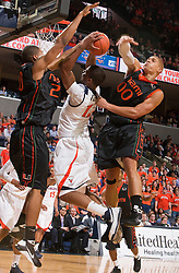 Miami (FL) forward Cyrus McGowan (20) blocks a shot by Virginia forward Jamil Tucker (12).  The Virginia Cavaliers fell to the Miami Hurricanes 62-55 at the John Paul Jones Arena on the Grounds of the University of Virginia in Charlottesville, VA on February 26, 2009.