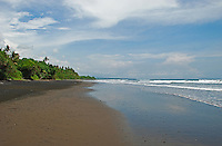 Beautiful, Rambut Siwi beach in Bali, Indonesia - looking east along the deserted sandy shore.