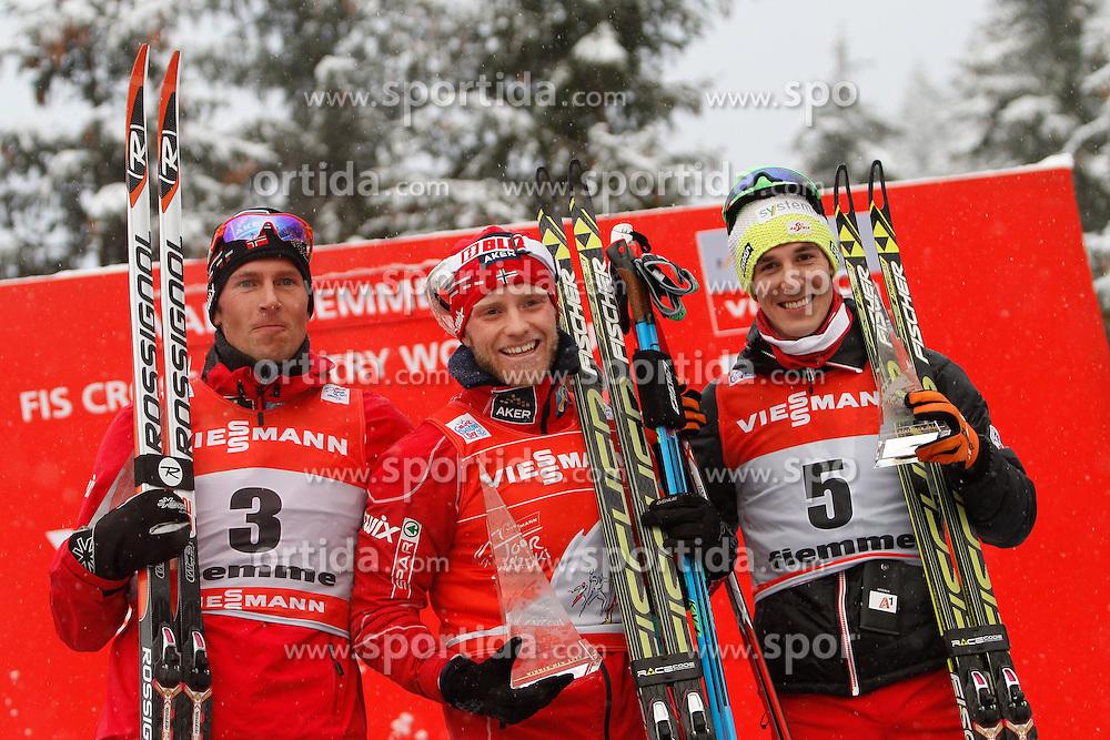 05.01.2014, Langlaufstadion, Alpe Cermis, ITA, FIS Tour de Ski, Langlauf Herren, Individual Start 9 Km, im Bild Di Sundby Martin (NOR) with Jespersen Chris (NOR) & Duerr Johannes (AUT) // during the Men 9 km Pursuit Cross Country of the FIS Tour de Ski 2014 at the Cross Country Stadium, Lago di Tesero, Italy on 2014/01/05. EXPA Pictures © 2013, PhotoCredit: EXPA/ Federico Modica