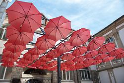 Red umbrellas by the entrance in Maribor Castle in Maribor, Slovenia on 27th of September.  Photo by Milos Vujinovic / Sportida