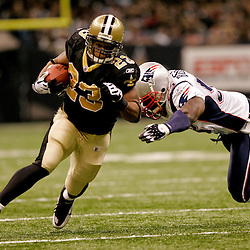 2009 November 30:  New Orleans Saints running back Pierre Thomas (23) runs away from New England Patriots linebacker Tyrone McKenzie (53) during a 38-17 win by the New Orleans Saints over the New England Patriots at the Louisiana Superdome in New Orleans, Louisiana.