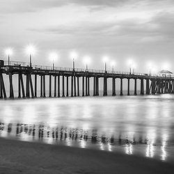 Panoramic Huntington Beach Pier black and white photo.  Huntington Beach is a popular Southern California coastal city in the Western United States.