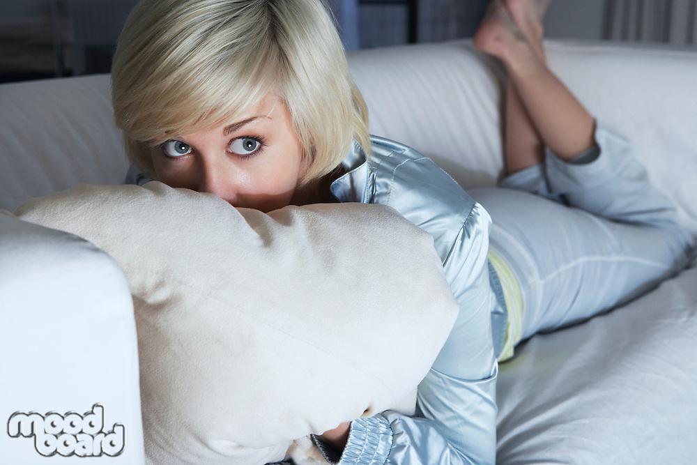 Woman lying on sofa looking on side