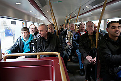 © licensed to London News Pictures. London, UK 27/02/2012. People inside the new Routemaster bus.  London's newly designed hop-on, hop-off double decker bus services begin today 27th February 2012 as the first bus leaves Hackney Bus Garage this morning. Photo credit: Tolga Akmen/LNP