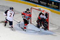 KELOWNA, CANADA, OCTOBER 29: Cody Chikie #14 of the Kelowna Rockets looks for the pass in front of Kamloops goaltender Cam Lanigan #30 as the Kamloops Blazers visit the Kelowna Rockets  on October 29, 2011 at Prospera Place in Kelowna, British Columbia, Canada (Photo by Marissa Baecker/Shoot the Breeze) *** Local Caption *** Cody Chikie; Cam Lanigan;