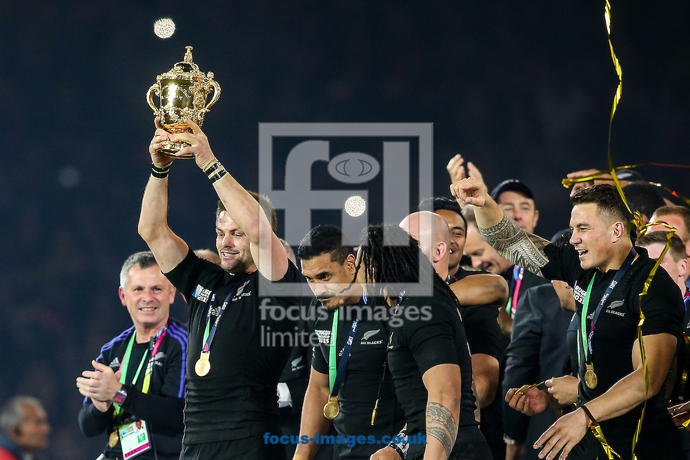 Richie McCaw of New Zealand (left) holds the World Cup trophy aloft after the final of the 2015 Rugby World Cup at Twickenham Stadium, Twickenham<br /> Picture by Andy Kearns/Focus Images Ltd 0781 864 4264<br /> 31/10/2015
