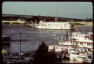 Delta Queen paddlewheeler nears St Louis' Eads Bridge, finish of race w/ Mississppi Queen;VP Fair Missouri