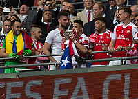 Football - 2017 FA Cup Final - Arsenal vs. Chelsea<br /> <br /> Alexis Sanchez of Arsenal kisses the FA cup at Wembley.<br /> <br /> COLORSPORT/DANIEL BEARHAM