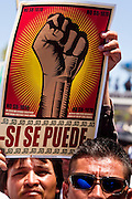 "May 29 - PHOENIX, AZ: A man holds up a si se puede (""Yes We Can"") sign at a pro-immigrant rights rally in Phoenix Saturday. More than 30,000 people, supporters of immigrants' rights and opposed to Arizona SB1070, marched through central Phoenix to the Arizona State Capitol Saturday. SB1070 makes it an Arizona state crime to be in the US illegally and requires that immigrants carry papers with them at all times and present to law enforcement when asked to. Critics of the law say it will lead to racial profiling, harassment of Hispanics and usurps the federal role in immigration enforcement. Supporters of the law say it merely brings Arizona law into line with existing federal laws.  Photo by Jack Kurtz"