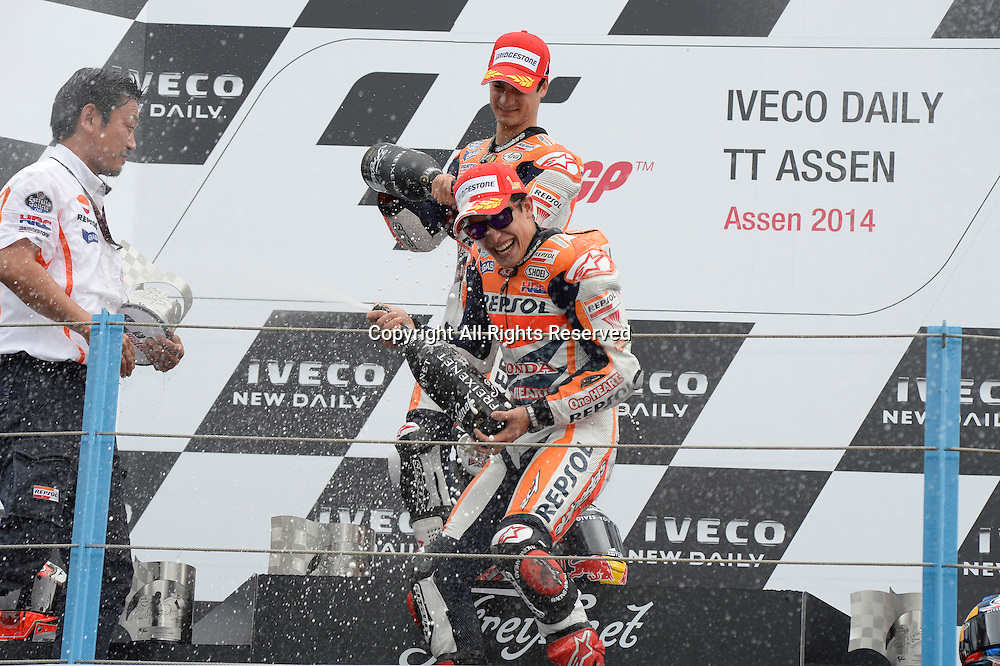 28.06.2014.  Assen, Netherlands. MotoGP. Iveco Daily TT Assen Race.Marc Marquez and Dani Pedrosa celebrate on podium.