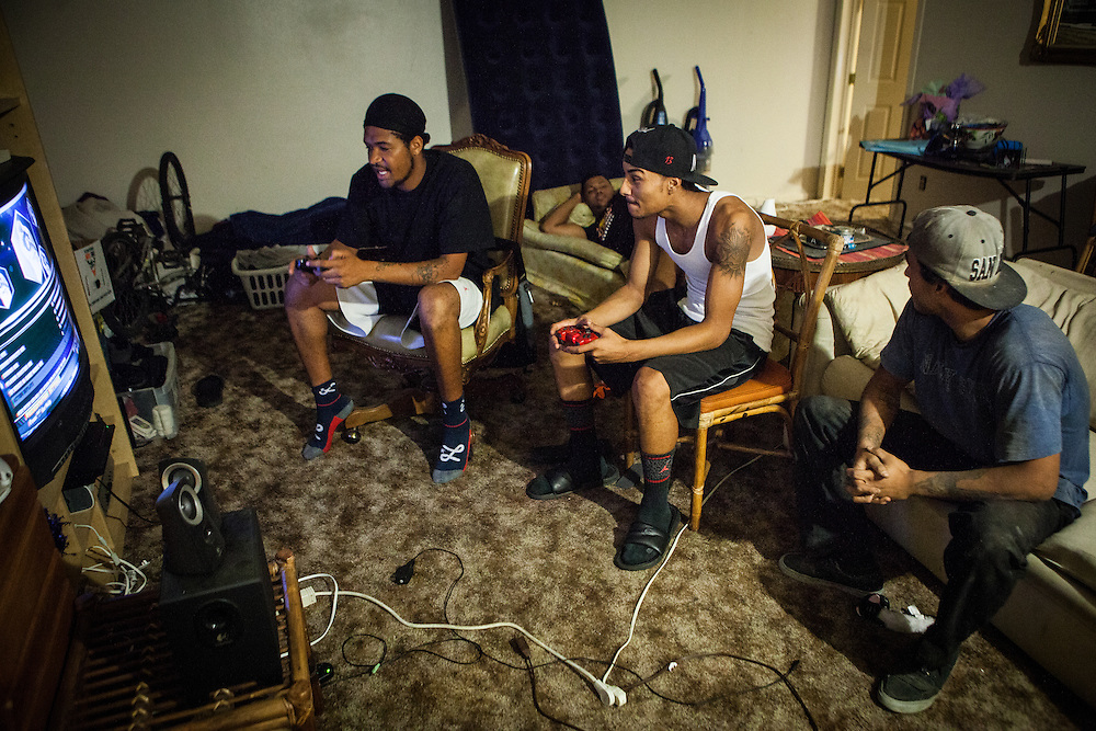 From left, Lerontae Trahan, Llijah Turner, Terrick Bakhit and Matt Bakhit relax and play video games in Spring Valley, California, September 24, 2014. All former foster youth, they spend a lot of time together and serve as a mutual support system. Terrick Bakhit is a former foster child who's struggled to make his way as an adult. He spent his 18th birthday incarcerated after a three-minute joyride in his group home van, so is unable to take advantage of AB12 – California legislation that gives assistance to foster youth as they transition into adulthood.
