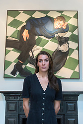 "© Licensed to London News Pictures. 04/09/2020. LONDON, UK. Ania Hobson (with ""The Chequered Floor"") at the preview of her new exhibition at Hampstead's Catto Gallery. In her debut solo London show, the former winner of the BP Portrait Young Artist Award is exhibiting her newest set of paintings which celebrate modern women, 5 to 23 September.  Photo credit: Stephen Chung/LNP"