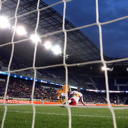 Bradley Wright-Phillips, New York Red Bulls, scores the first of his hat-trick of goals as he beats Houston Dynamo goalkeeper Tally Hall during the New York Red Bulls V Houston Dynamo, Major League Soccer regular season match at Red Bull Arena, Harrison, New Jersey. USA. 23rd April 2014. Photo Tim Clayton