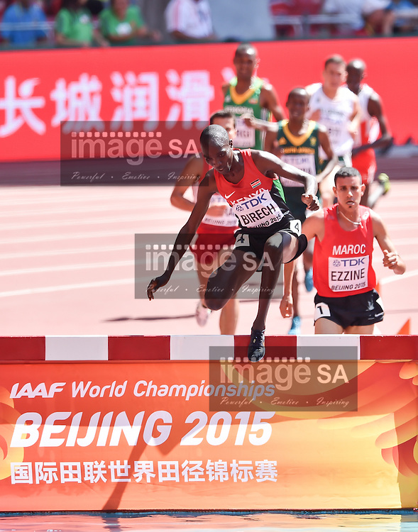 BEIJING, CHINA - AUGUST 22: Jairus Kipchoge Birech (Kenya) at the water jump in Round 1 of the mens 3000m steeplechase during day 1 of the 2015 IAAF World Championships at National Stadium on August 22, 2015 in Beijing, China. (Photo by Roger Sedres/Gallo Images)