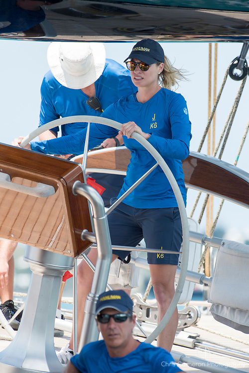 The Great Sound, Bermuda, 17th June America's Cup J Class parade. Kristy Hinze, Australian model and wife of  US entrepreneur James Clarke owner of Hanuman (JK6) at the wheel.