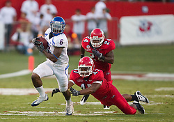 Sep. 18, 2009; Fresno, CA, USA; Boise State Broncos running back D.J. Harper (6) breaks a tackle from Fresno State Bulldogs defensive tackle Terrance Kindle (47) on a 60 yard touchdown rush during the second quarter at Bulldog Stadium.