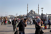 local Istanbul people near the Galata bridge with the Yeni Camii in the background