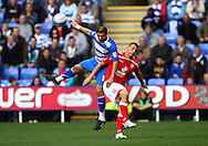 Zurab Khizanishvili of Reading (L) leaps for a header against Chris Wood of Barnsley (R) during the Npower Championship match between Reading and Barnsley on Saturday 25th September 2010 at the Madejski Stadium, Reading, UK. (Photo by Andrew Tobin/Focus Images)