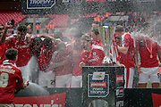 The Barnsley team celebrate with Champagne after the Johnstone's Paint Trophy Final between Barnsley and Oxford United at Wembley Stadium, London, England on 3 April 2016. Photo by Mark P Doherty.