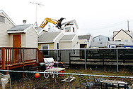 The claw of a demolition vehicle brings down Doreen Lagno's house, which was irreparably damaged by flood waters during Hurricane Sandy, in the Ocean Breeze neighborhood of Staten Island, New York, New York, USA, 15 January 2013. The United States House of Representatives is moving toward a vote today on allocating federal aid money to people who were affected by the Hurricane.