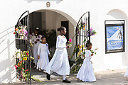Young members of the praise dance group of the Mother Emanuel African Methodist Episcopal Church walk out of the church during a ceremony marking the 2nd anniversary of the mass shooting June 17, 2017 in Charleston, South Carolina. Nine members of the historic African-American church were gunned down by a white supremacist during bible study on June 17, 2015.