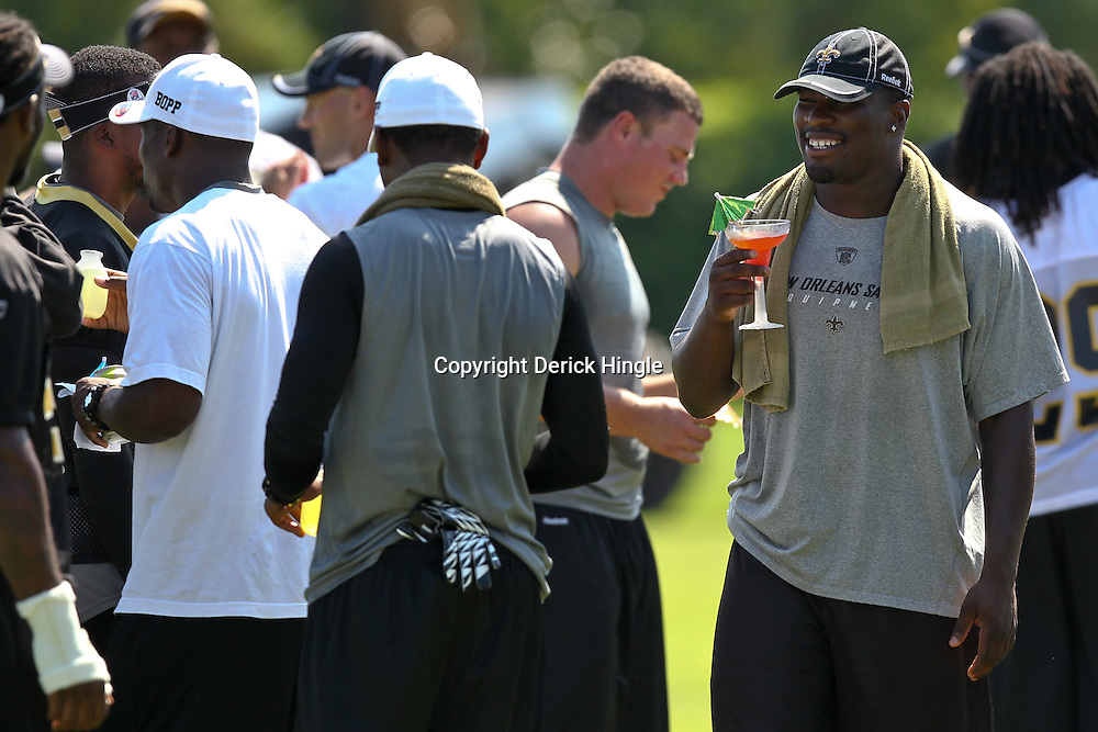 July 31, 2011; Metairie, LA, USA; New Orleans Saints linebacker Jo-Lonn Dunbar holds a Shirley Temple drink after coach Sean Payton handed out the drinks to veterans who are unable to practice during training camp practice at the New Orleans Saints practice facility. Mandatory Credit: Derick E. Hingle