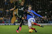 Portsmouth defender Adam Webster tackles York City forward Emile Sinclair during the Sky Bet League 2 match between Portsmouth and York City at Fratton Park, Portsmouth, England on 24 November 2015. Photo by Simon Davies.