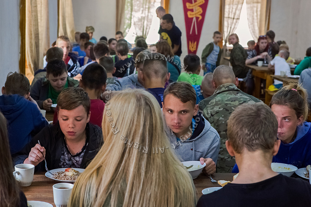 Youngsters participating to the ultra-nationalistic Azovets children's camp are eating breakfast together, on the banks of the Dnieper river in Kiev, Ukraine's capital.