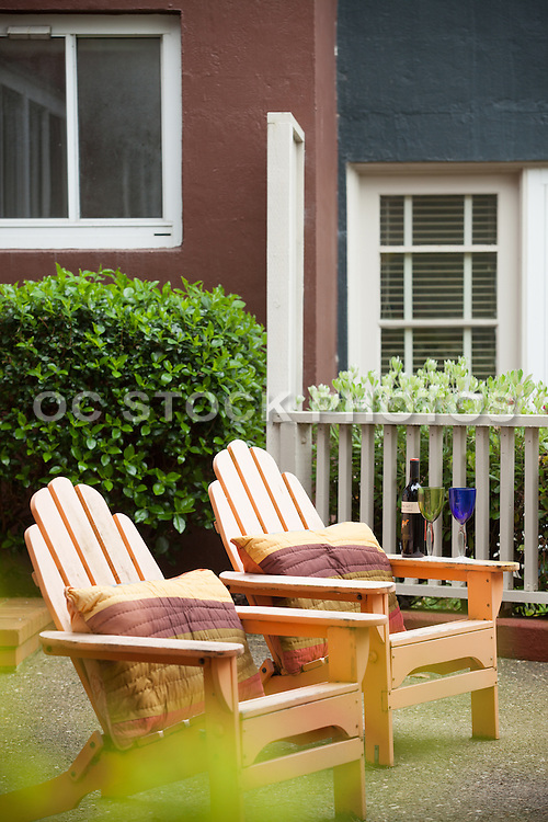 Vertical Stock Photo of Wood Adirondack Chairs on the Patio