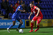 AFC Wimbledon attacker Michael Folivi (17) taking on Leyton Orient defender Josh Coulson (6) during the Leasing.com EFL Trophy match between AFC Wimbledon and Leyton Orient at the Cherry Red Records Stadium, Kingston, England on 8 October 2019.