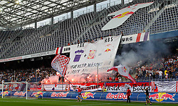 17.07.2011, Red Bull Arena, Salzburg, AUT, 1. FBL, FC Red Bull Salzburg vs Austria Wien, im Bild Fans, Red Bull, Bengalische Feuer, Transparent, EXPA Pictures © 2011, PhotoCredit: EXPA/ D. Scharinger