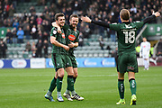 Graham Carey (10) of Plymouth Argyle celebrates scoring a goal to give a 1-0 lead to the home team with David Fox (24) of Plymouth Argyle and Oscar Threlkeld (18) of Plymouth Argyle during the EFL Sky Bet League 2 match between Plymouth Argyle and Morecambe at Home Park, Plymouth, England on 18 March 2017. Photo by Graham Hunt.