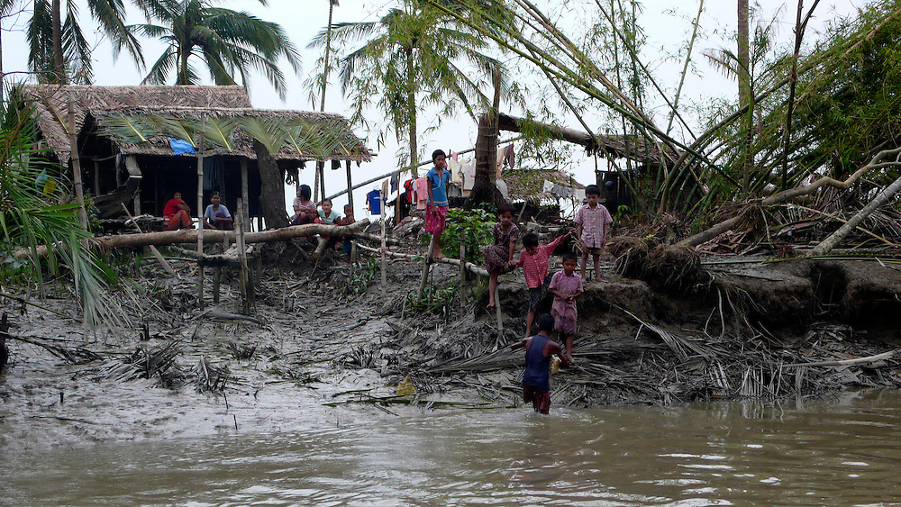 Villagers desperately waiting for food and water supply in the aftermath of the cyclone Nargis.